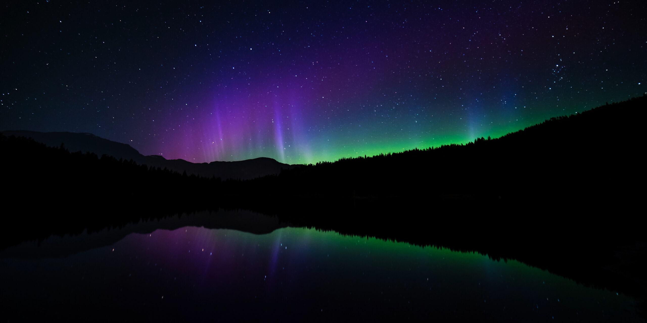Northern Lights above a calm lake at night