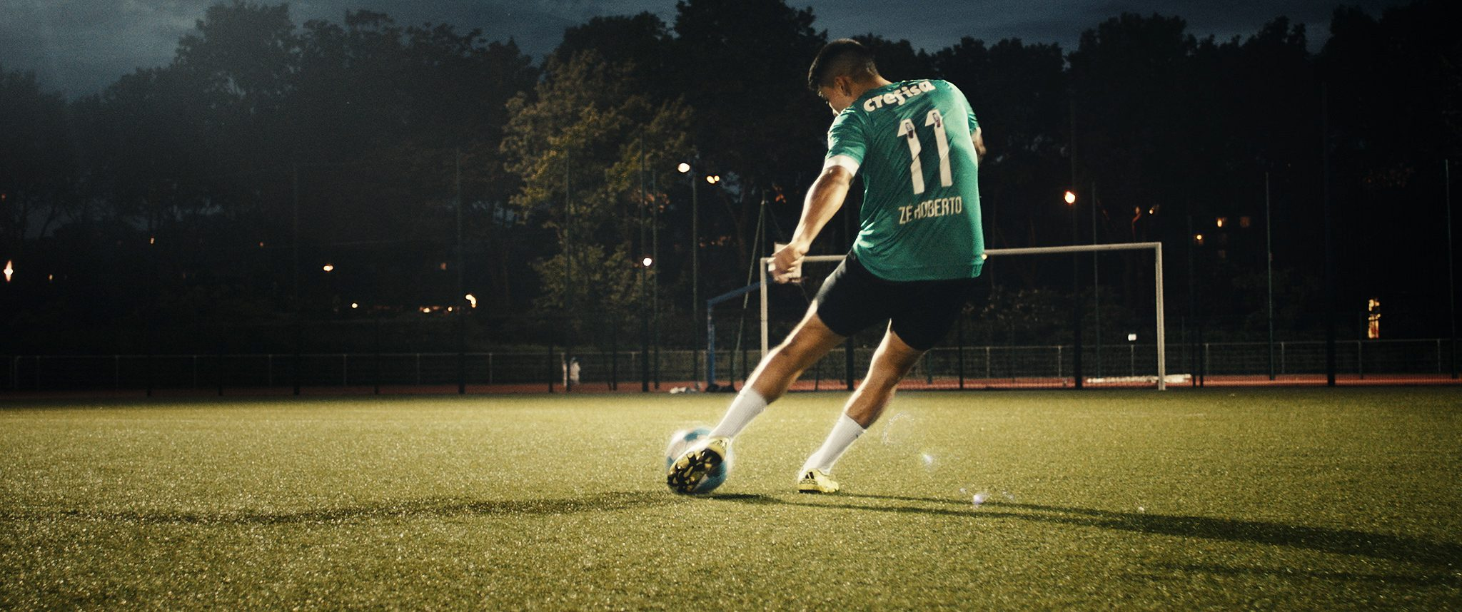 Soccer Player kicks the ball