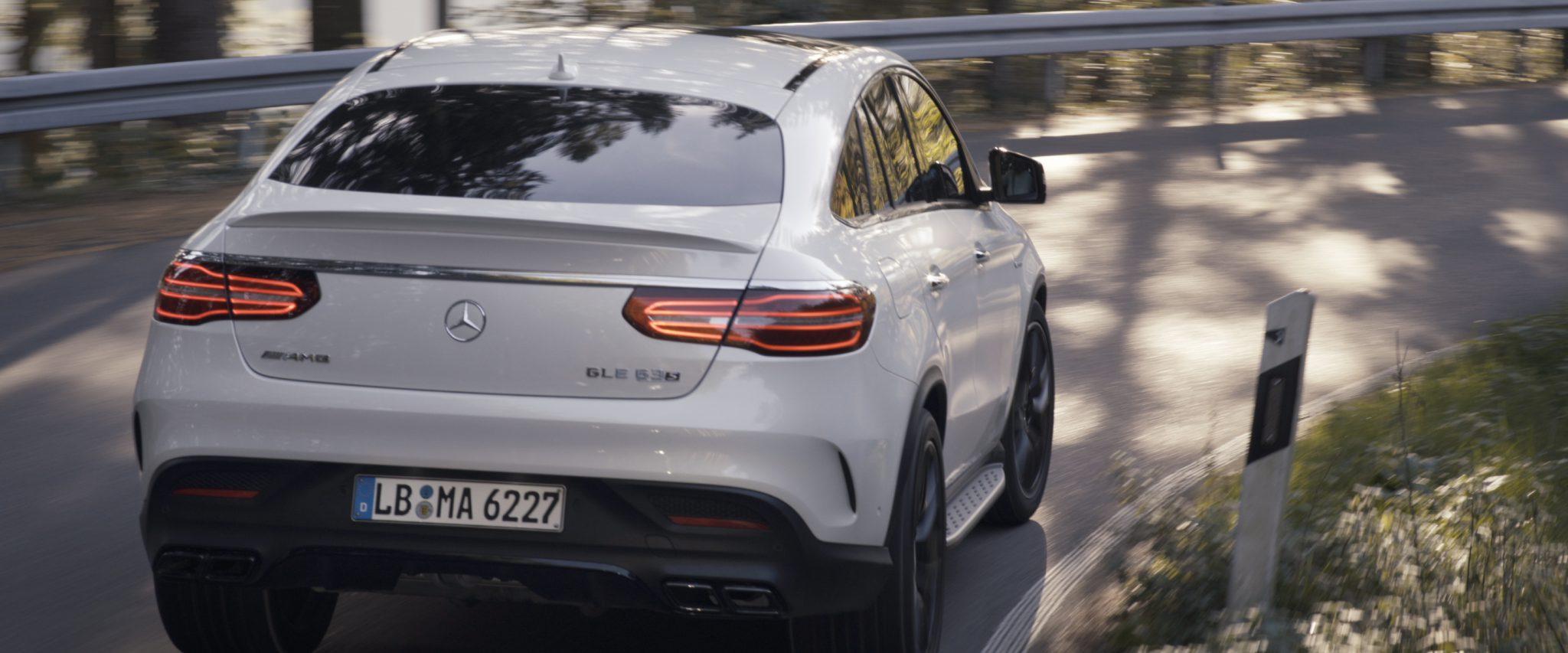 Mercedes-Benz driving around the corner