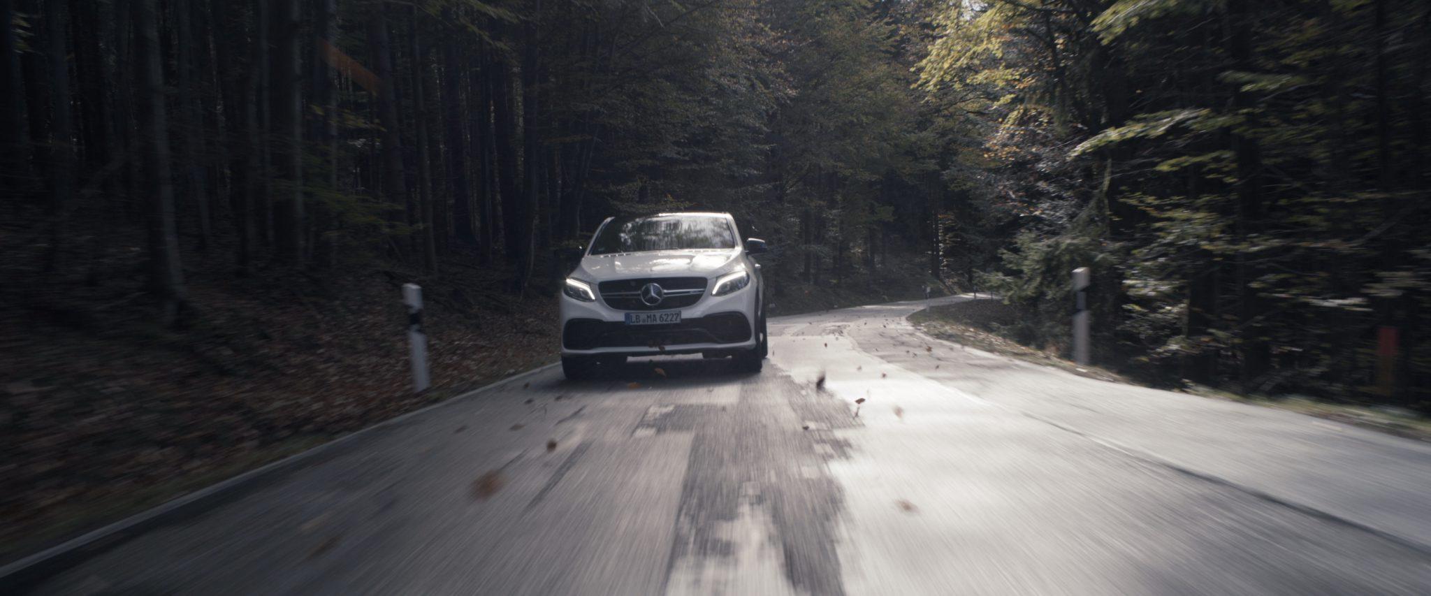 Mercedes-Benz car driving through deep forest