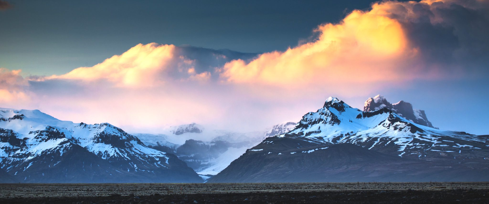 Sunset Panorama of snowy mountains
