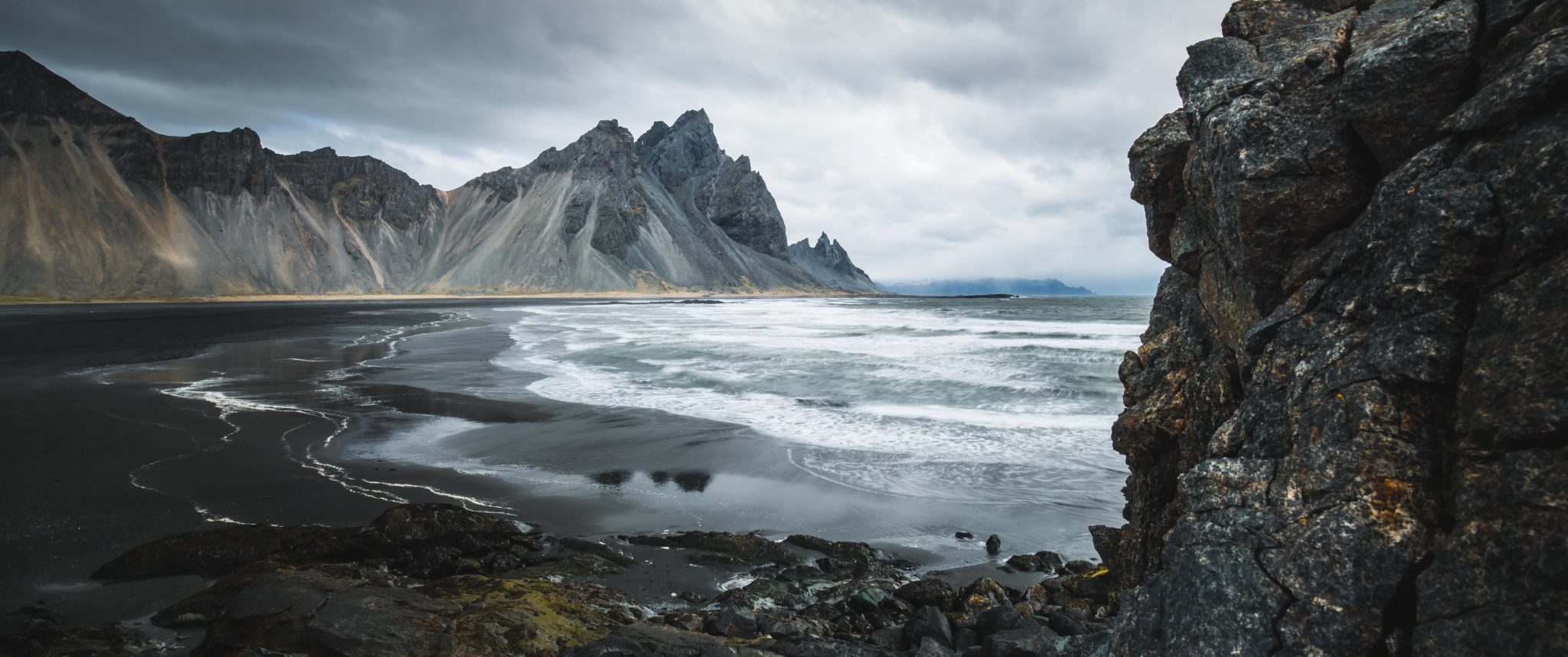 Waves rolling into rough shore in iceland
